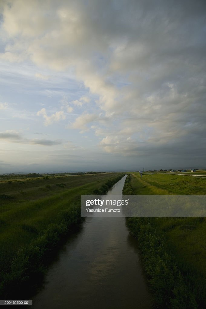 River running through field : Stock Photo