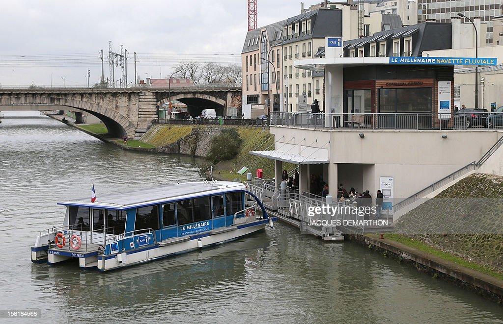 A river shuttle 'Le Millenaire' prepares to dock at the Saint-Denis canal, on December 10, 2012, in Paris.