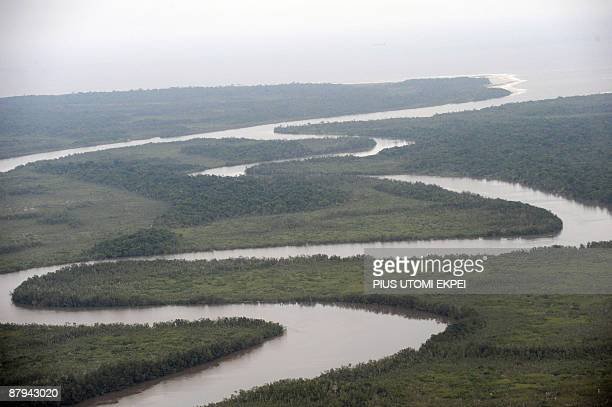 A river snakes in the Niger Delta mangrove forest some 200 kms from Port Harcourt on May 23 2009 French Prime Minister Francois Fillon flew over the...