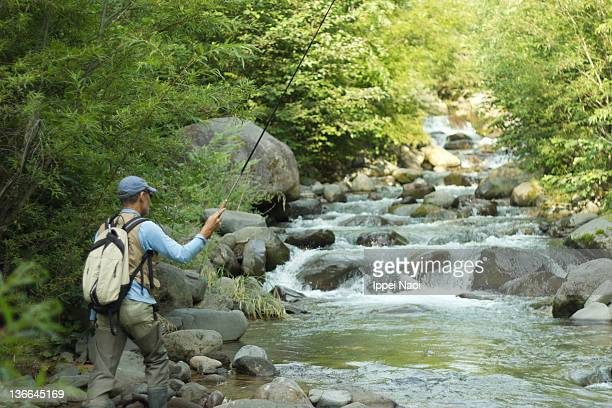 River stream fishing in forest