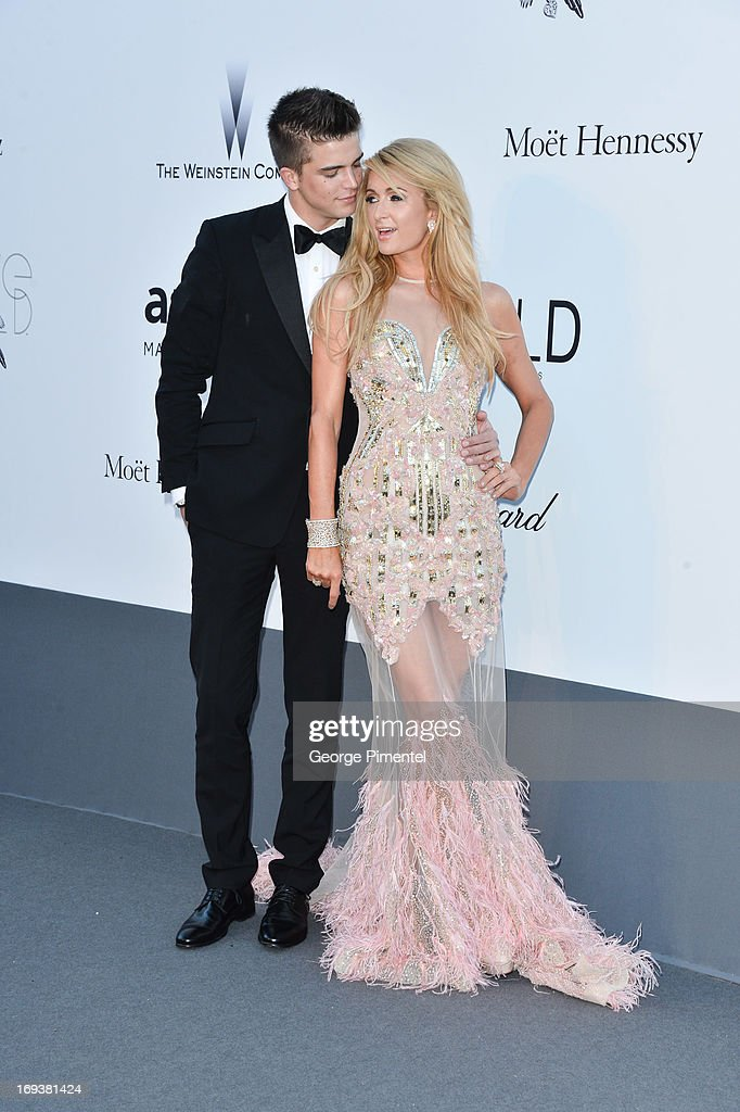 River Viiperi and Paris Hilton arrive at amfAR's 20th Annual Cinema Against AIDS at Hotel du Cap-Eden-Roc on May 23, 2013 in Cap d'Antibes, France.