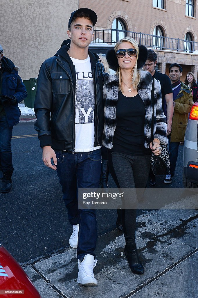 River Viiperi (L) and TV personality Paris Hilton walks in Park City on January 20, 2013 in Park City, Utah.