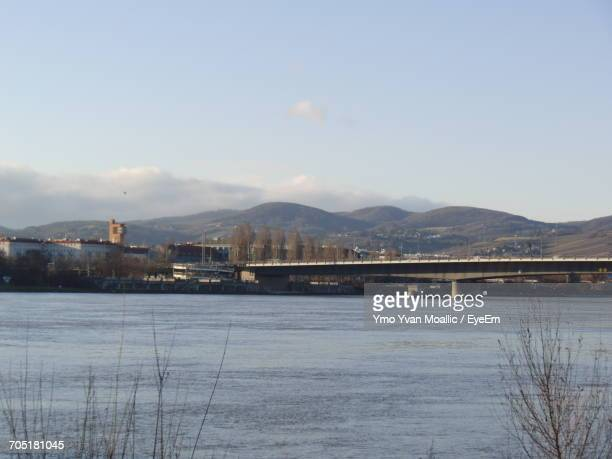 River With Mountain Range In Background