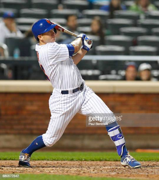 TJ Rivera of the New York Mets bats in an MLB baseball game against the Miami Marlins on May 5 2017 at CitiField in the Queens borough of New York...