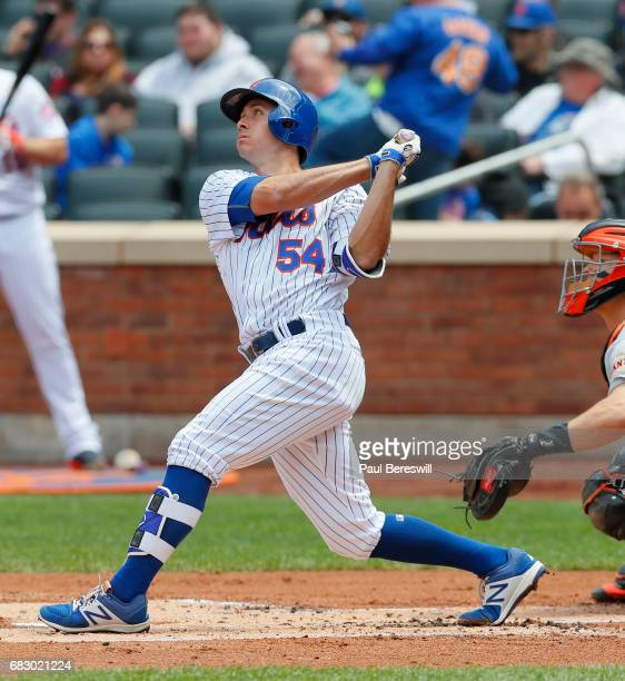 TJ Rivera of the New York Mets bats in an MLB baseball game against the San Francisco Giants on May 10 2017 at CitiField in the Queens borough of New...