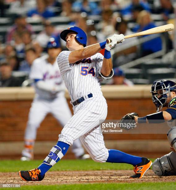 J Rivera of the New York Mets bats in an MLB baseball game against the Milwaukee Brewers on May 31 2017 at CitiField in the Queens borough of New...