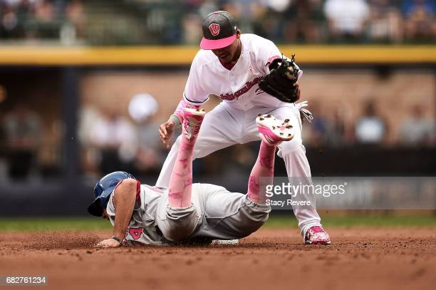 J Rivera of the New York Mets beas a tag by Orlando Arcia of the Milwaukee Brewers during the second inning of a game at Miller Park on May 13 2017...