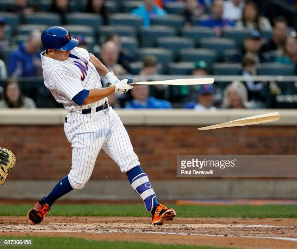 J Rivera of the New York Mets breaks his bat and reaches first on a fielders choice in an interleague MLB baseball game against the Los Angeles...