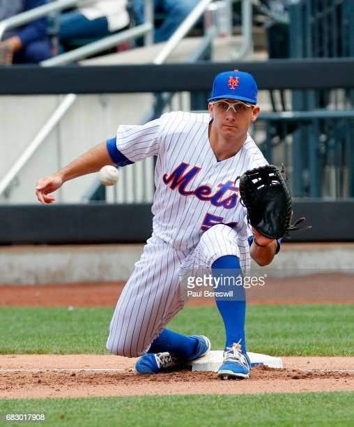 TJ Rivera of the New York Mets catches a throw at first base for an out against the San Francisco Giants in an MLB baseball game on May 10 2017 at...