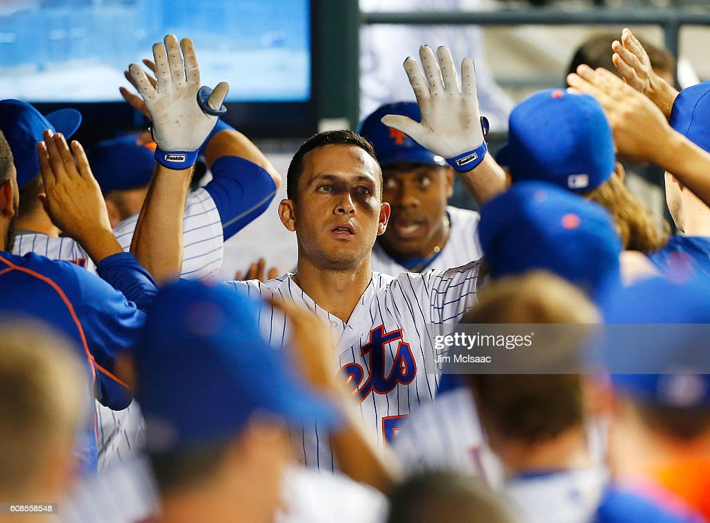 T.J. Rivera #54 of the New York Mets celebrates his fourth-inning, two-run home run against the Atlanta Braves at Citi Field on September 19, 2016 in the Flushing neighborhood of the Queens borough of New York City.