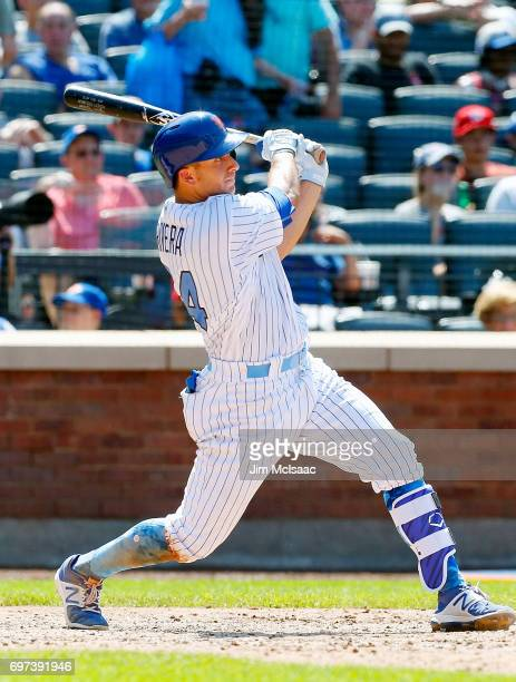 J Rivera of the New York Mets follows through on a single in the seventh inning against the Washington Nationals at Citi Field on June 18 2017 in the...