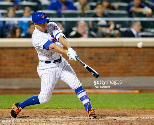 J Rivera of the New York Mets hits a fly ball in an MLB baseball game against the San Diego Padres on May 24 2017 at CitiField in the Queens borough...