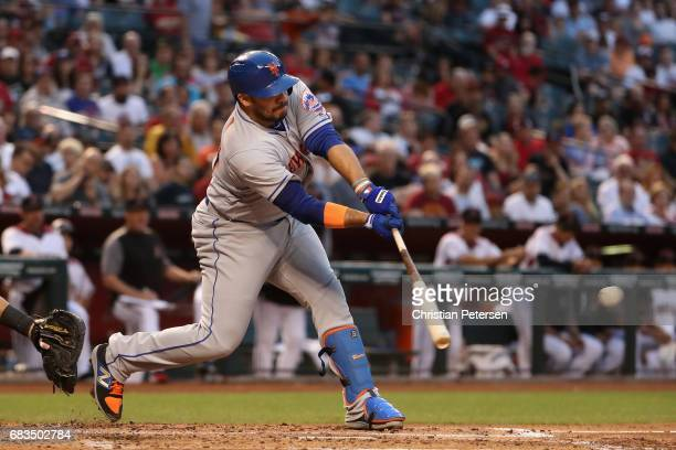 J Rivera of the New York Mets hits a RBI single against the Arizona Diamondbacks during the second inning of the MLB game at Chase Field on May 15...