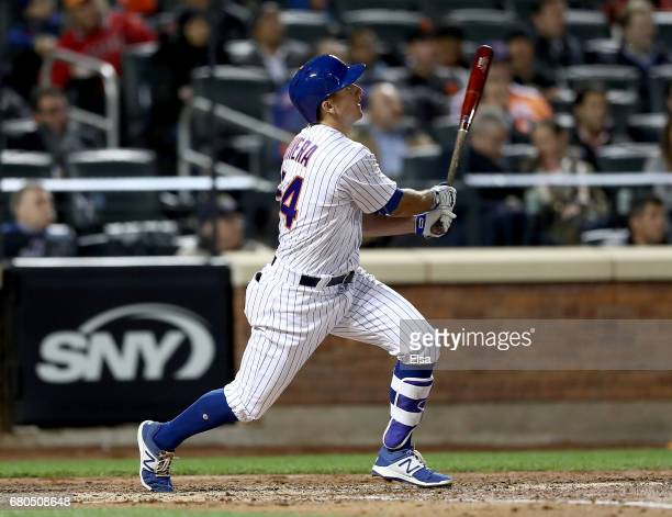 J Rivera of the New York Mets hits an RBI double in the fifth inning against the San Francisco Giants on May 8 2017 at Citi Field in the Flushing...