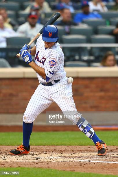 J Rivera of the New York Mets is hit by a pitch in the second inning against the Washington Nationals at Citi Field on June 16 2017 in the Flushing...
