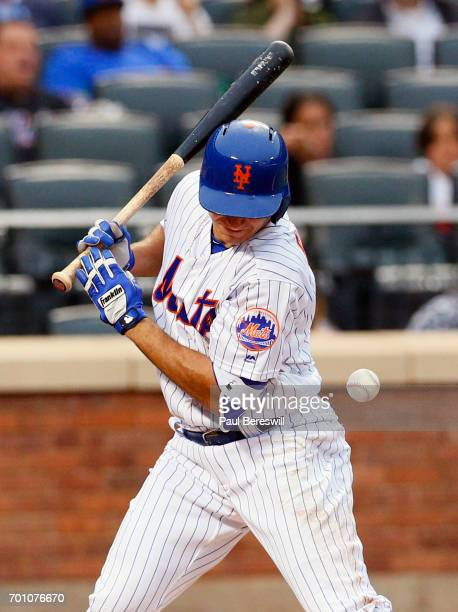 J Rivera of the New York Mets is hit by a pitch while batting in an MLB baseball game against the Washington Nationals on June 16 2017 at CitiField...