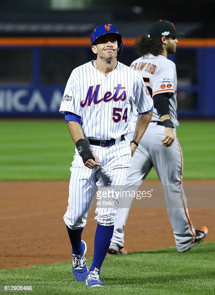J Rivera of the New York Mets reacts after being caught in a rundown by Joe Panik and Brandon Crawford of the San Francisco Giants in the fifth...