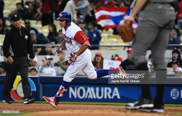 J Rivera of the Puerto Rico runs the bases after hitting a home run to give them a 32 lead in the second inning against team Netherlands during Game...