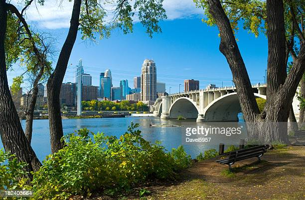 Riverbank park, Mississippi River, and Minneapolis downtown skyline