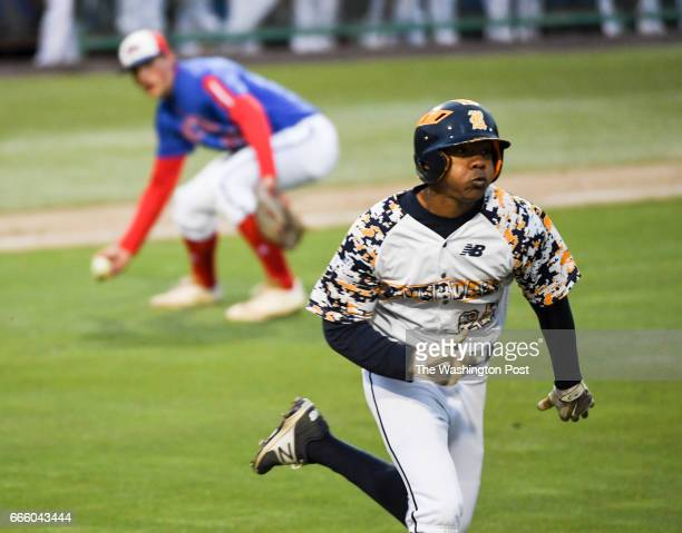 Riverdale Baptist pitcher Harold Cortijo runs out a bunt to first base as DeMatha pitcher Thomas Keehn in Bowie MD on April 7 2017
