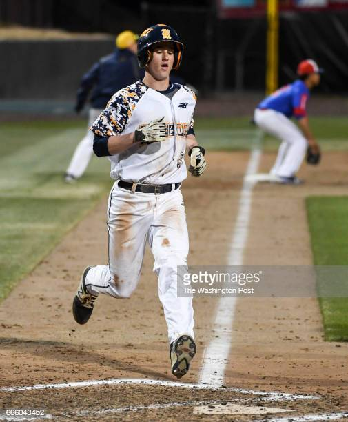 Riverdale Baptist's Ben Blackwell scores in the sixth during action against DeMatha in Bowie MD on April 7 2017