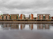 Modern houses reflecting on the Newport riverfront in South Wales