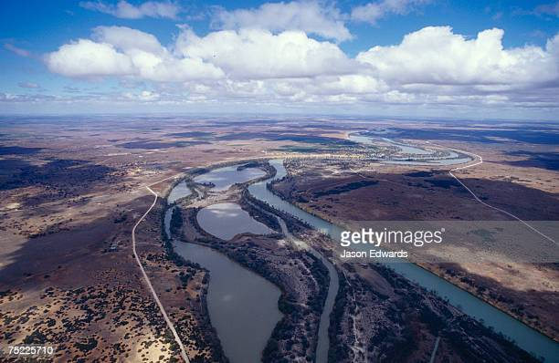 Aerial of the winding Murray River, wetlands and cloud formations.
