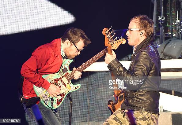 Rivers Cuomo and Scott Shriner of the band Weezer perform onstage at 1067 KROQ Almost Acoustic Christmas 2016 Night 2 at The Forum on December 11...