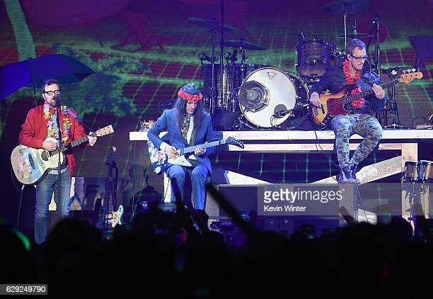 Rivers Cuomo Brian Bell and Scott Shriner of the band Weezer perform onstage at 1067 KROQ Almost Acoustic Christmas 2016 Night 2 at The Forum on...