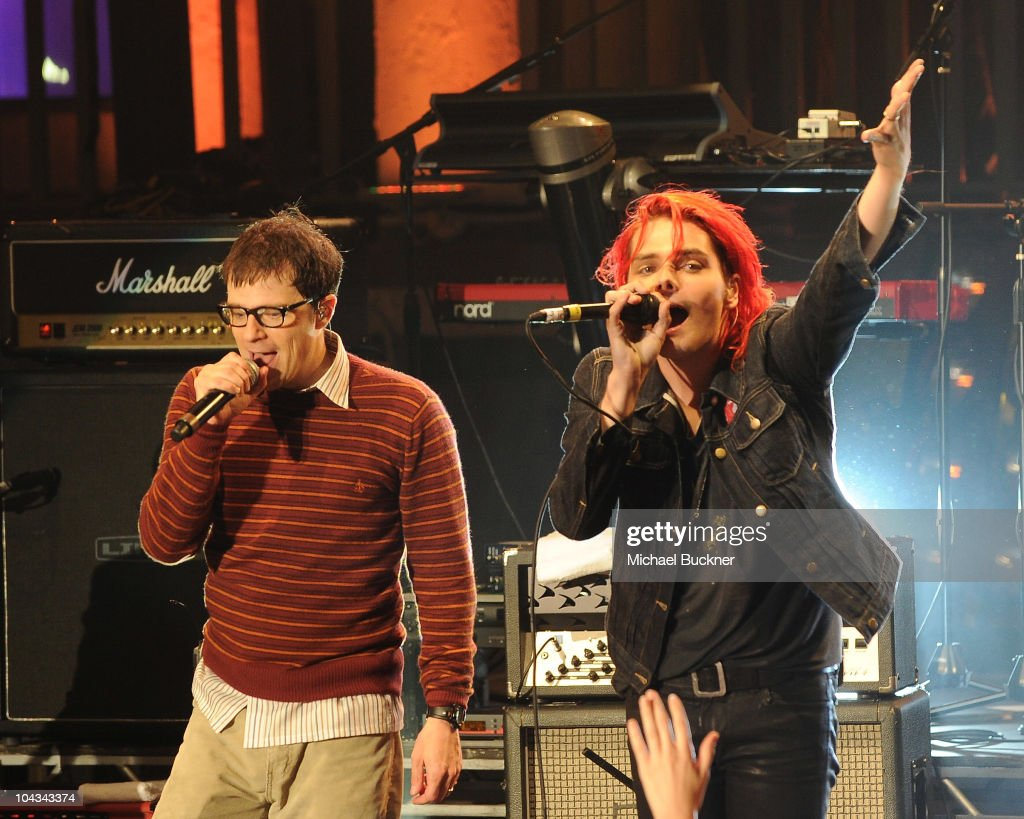 Rivers Cuomo of Weezer (L) and Gerard Way of My Chemical Romance perform at the 'AXE Music One Night Only' concert series featuring Weezer at Dunes Inn Motel - Sunset on September 21, 2010 in Hollywood, California.