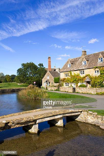 Riverside cottages at Lower Slaughter in autumn sunshine, Gloucestershire, UK