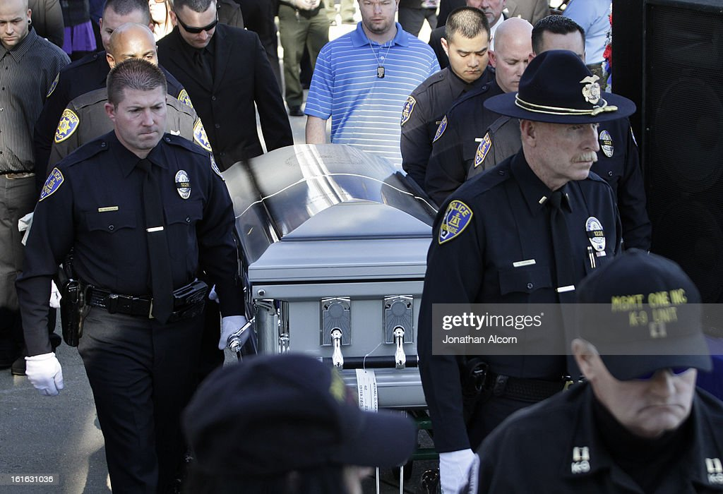 Riverside Police carry the coffin of officer Michael Crain during his committal ceremony at Riverside National Cemetery on February 13, 2013 in Riverside, California. Officer Crain was allegedly killed by ex LAPD officer Chris Dorner on February 7, 2013.