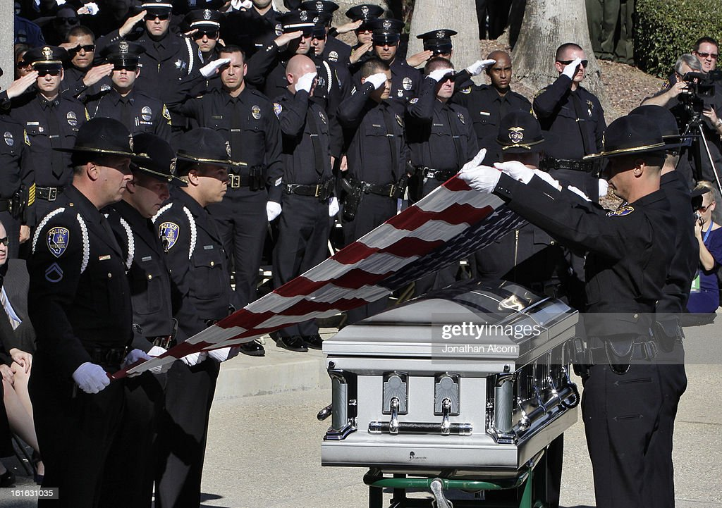 Riverside Police honor guard folds the flag from the coffin of officer Michael Crain during his committal ceremony at Riverside National Cemetery on February 13, 2013 in Riverside, California. Officer Crain was allegedly killed by ex LAPD officer Chris Dorner on February 7, 2013.