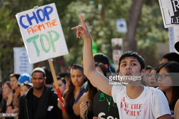 Riverside student Andrew Ojeda and other University of California Los Angeles students and supporters protest as the UC Board of Regents votes to...
