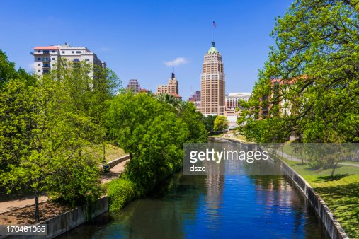 Riverwalk San Antonio Texas skyline, park walkway along scenic canal