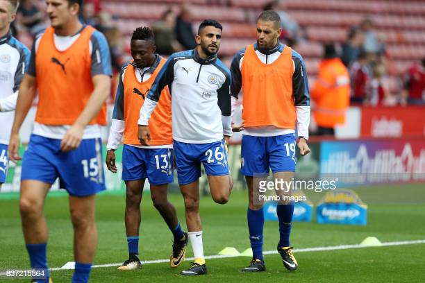 Riyad Mahrez and Islam Slimani of Leicester City warm up at Bramall Lane ahead of the Carabao Cup Second Round tie between Sheffield United and...