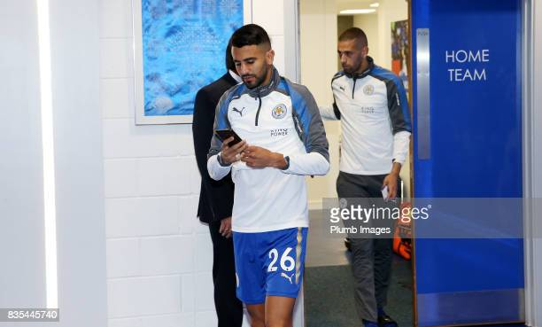 Riyad Mahrez arrives ahead of the Premier League match between Leicester City and Brighton and Hove Albion at King Power Stadium on August 19 2017 in...