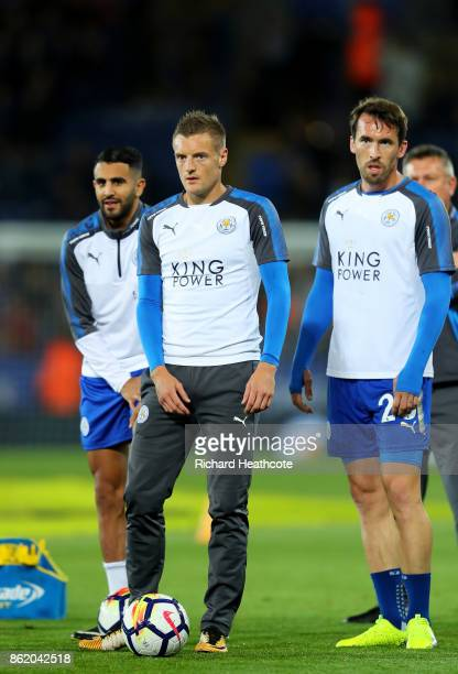 Riyad Mahrez Jamie Vardy and Christian Fuchs of Leicester City warm up ahead of the Premier League match between Leicester City and West Bromwich...