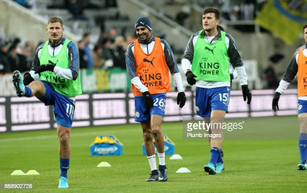 Riyad Mahrez Marc Albrighton and Harry Maguire of Leicester City warm up at St James Park ahead of the Premier League match between Newcastle United...