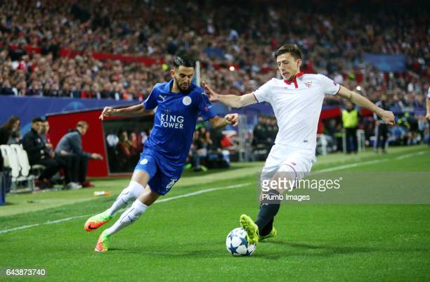 Riyad Mahrez of Leciester City in action with Stevan Jovetic of Sevilla during the UEFA Champions League Round of 16 First Leg between Sevilla FC and...