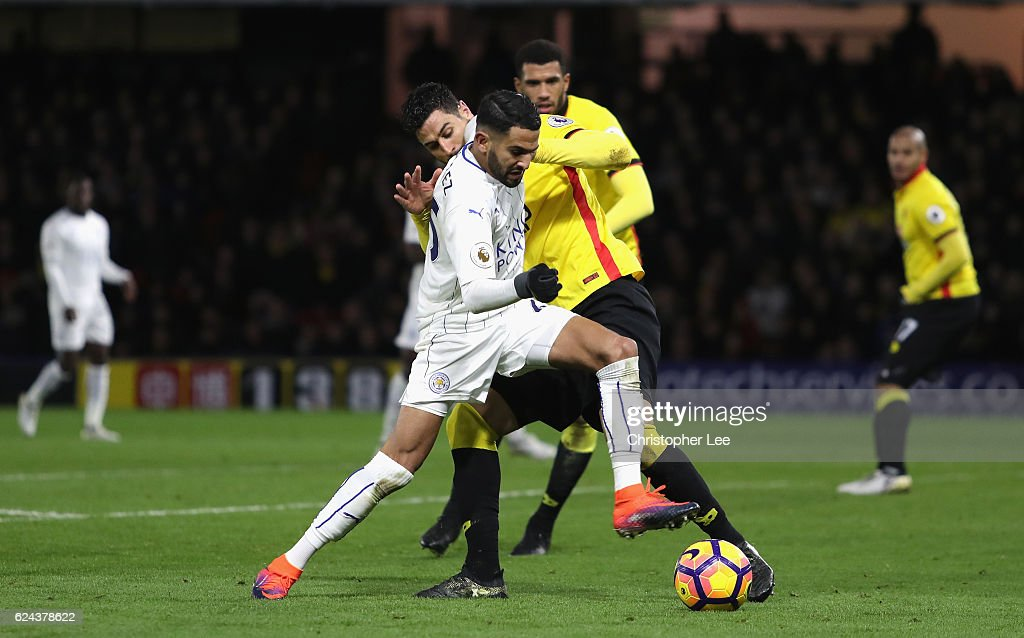 Riyad Mahrez of Leicester battles for the ball with Miguel Britos of Watford during the Premier League match between Watford and Leicester City at Vicarage Road on November 19, 2016 in Watford, England.