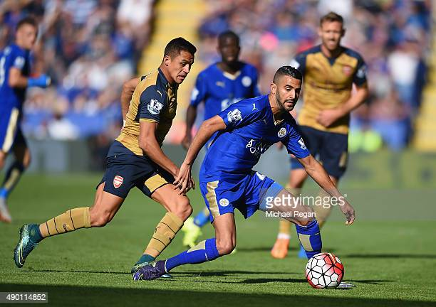 Riyad Mahrez of Leicester City and Alexis Sanchez of Arsenal compete for the ball during the Barclays Premier League match between Leicester City and...