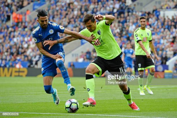 Riyad Mahrez of Leicester City and Charlie Daniels of AFC Bournemouth battle for possession during the Premier League match between Leicester City...