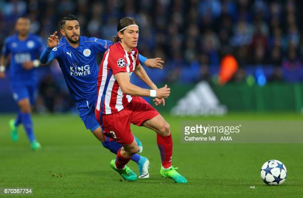 Riyad Mahrez of Leicester City and Filipe Luis of Atletico Madrid during the UEFA Champions League Quarter Final second leg match between Leicester...