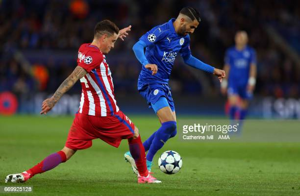Riyad Mahrez of Leicester City and Jose Gimenez of Atletico Madrid during the UEFA Champions League Quarter Final second leg match between Leicester...