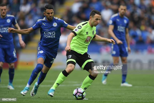 Riyad Mahrez of Leicester City and Marc Pugh of AFC Bournemouth battle for the ball during the Premier League match between Leicester City and AFC...