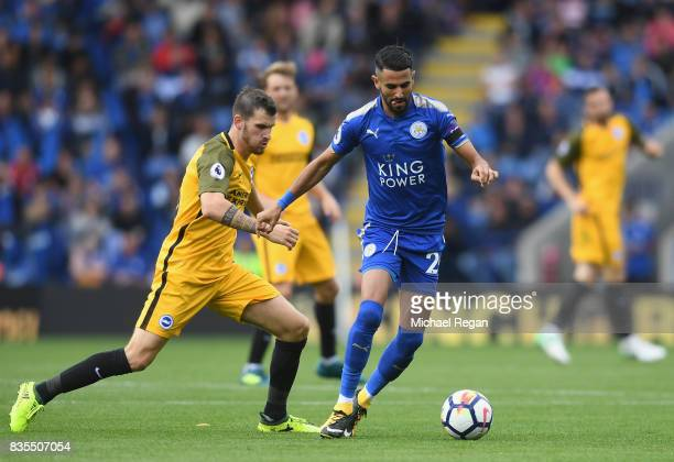 Riyad Mahrez of Leicester City and Pascal Grob of Brighton and Hove Albion during the Premier League match between Leicester City and Brighton and...