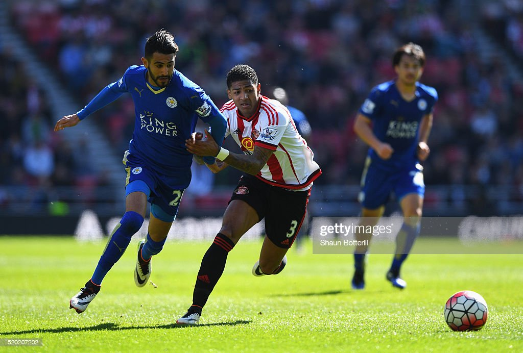 Riyad Mahrez of Leicester City and Patrick van Aanholt of Sunderland chase the ball during the Barclays Premier League match between Sunderland and...
