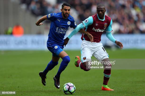Riyad Mahrez of Leicester City and Pedro Mba Obiang of West Ham during the Premier League match between West Ham United and Leicester City at London...