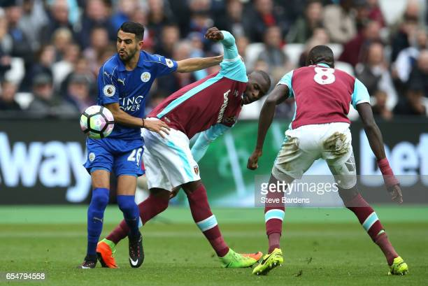 Riyad Mahrez of Leicester City and Pedro Obiang of West Ham United battle for possession during the Premier League match between West Ham United and...